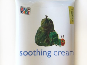 Close up of label with very hungry caterpillar crawling out of a pear on episencial soothing cream