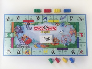 Monopoly Junior board game by Hasbro set up to play with carnival kids edition