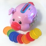 Fisher price laugh and learn piggy bank musical toy pink pig with colored coins