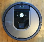 irobot roomba vacuum in silver and black