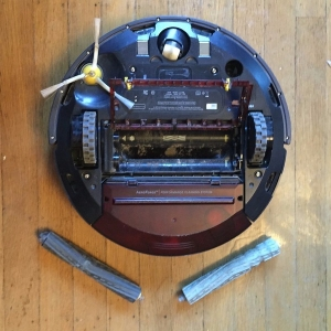 Roomba upside down with cleaning brushes removed
