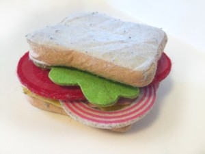 Sandwich on white bread made with melissa and doug felt pieces