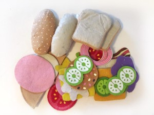 Melissa and Doug felt food set with random assortment of pieces in a pile