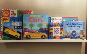 Books displayed on white picture ledge shelf
