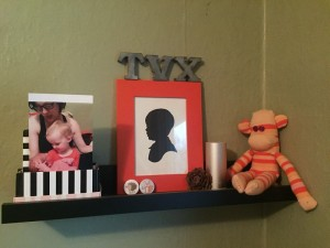 Objects and art displayed on a picture ledge floating shelf