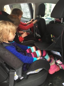 Kids three in one row with two rubbermaid back seat fold down organizers