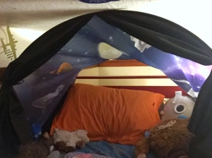 Dream tent in space adventure set up in loft bed bed with curtains tied back