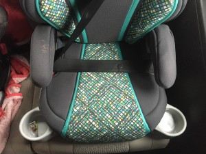 Graco Turbobooster booster car seat bottom portion with seatbelt fastened over it and cup holders extended