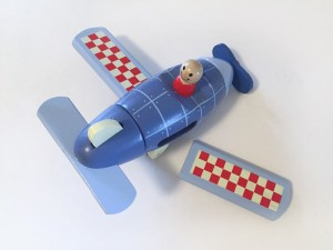 Janod magnetic airplane assembled with one red and white checkered wing detached