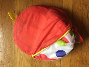 Kuuqa Kids pop up toddler ball pit folded and partially inside zippered storage bag