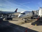 Delta airplanes parked at airport apron gate terminal
