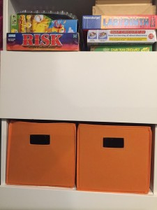 Storage bins in orange on Besta storage shelf
