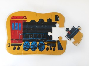 Locomotive train twelve piece puzzle from Crocodile Creek with one piece left unassembled