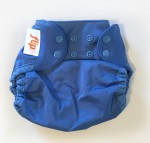 Flip cloth diaper cover in blue snapped down to newborn size