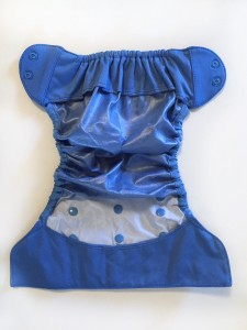 Flip diaper cover laid out with inside visible