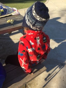 Child wearing Hatley fuzzy fleece jacket in red with ski snow print