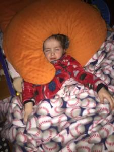 Toddler sleeping in Hatley fuzzy fleece jacket