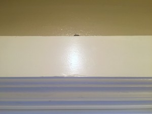 Windowsill with small key peeking over the edge