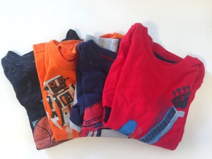 size 3T shirts folded into squares to pack in suitcase