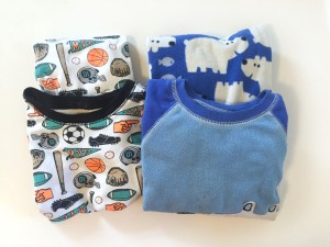 Kids pajamas regular and fleece folded side by side for packing purposes