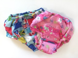 Reusable iplay swim diapers in pink and flag patterns