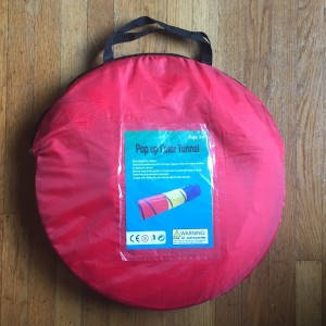 Pop up tunnel inside red storage bag carrying case included with purchase
