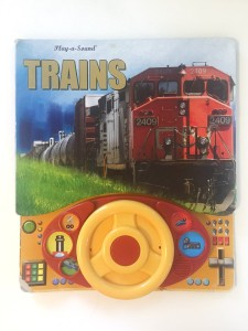 Trains play a sound steering wheel board book