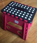 Acko step stool folding compact red with black surface and white dots
