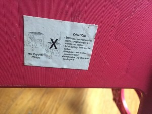 Warnings on side of folding step stool