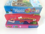 Three Little PIggies Chickyboom Four First Games board games for toddlers in a stack