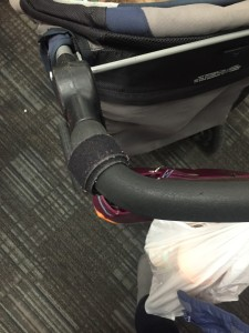 Velcro fastening tape wrapped around stroller handle