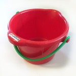 Spielstabil small sand pail bucket in red with green handle empty