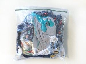 Kid clothes contained in gallon clear resealable bag