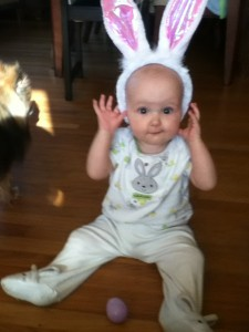 Baby in bunny ears and Easter outfit