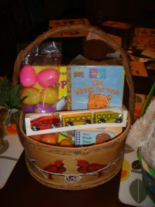 Easter basket for three year old stuffed with IKEA trains, books, and plastic eggs filled with playfoam