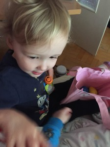 Preschooler digging through Easter bag during trip abroad