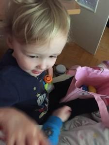 Preschooler digging through Easter bag during trip abroad