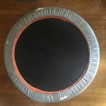 Exercise trampoline 36 inch with silver spring cover on hardwood floor