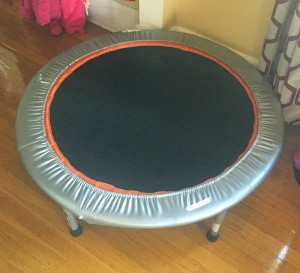 Exercise trampoline for adults set up in middle of floor