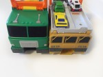 Matchbox launcher hot wheels car carrier garbage truck military vehicle load and spits out side by side front view