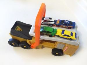 Military truck power launcher with four cars on top by Matchbox