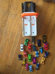 Matchbox power launcher military vehicle with lots of cars behind it