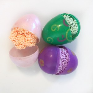 Three plastic Easter eggs filled with different colors of Playfoam