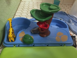 Playmobil take along zoo set up in bathroom by child