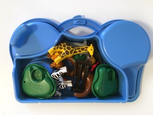 Playmobil take along zoo play set with pieces packed into blue side of carrying case