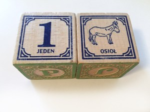 Close up of two Polish Uncle Goose ABC wooden blocks