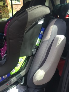 Middle row bucket seat with convertible car seat installed as viewed from side angle