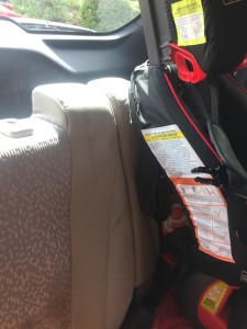 Graco Nautilus booster seat in back row of minivan as seen from the side