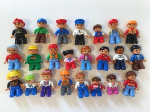 Duplo figurines lined up in three rows