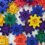 Learning resources gears gears gears in yellow purple blue green orange and red scattered in a pile